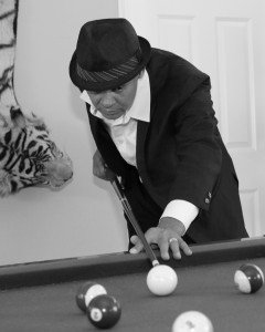 Neal playing pool up closer bw